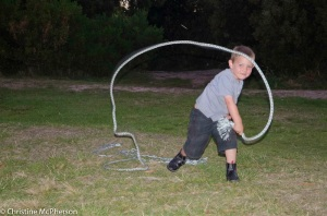 Matt making a whip out of rope he found