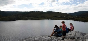 Sitting on the boulder on the Dove Lake walk