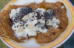 Gourmet breakfasts - pancakes, yogurt, poppy seeds, cacao, macadamias, maple syrup, coconut = YUM